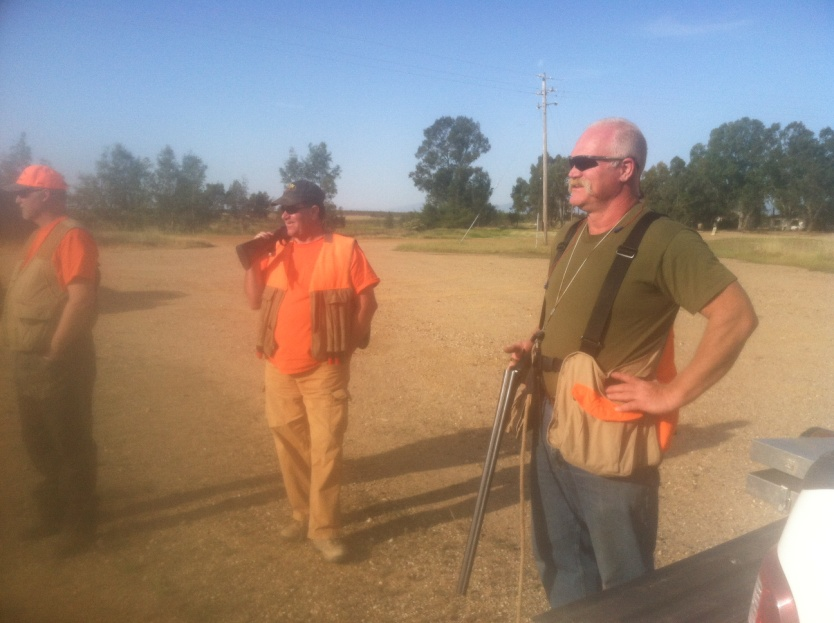 Text Box: Russ, Randy and Randy watching birds being released in the field.